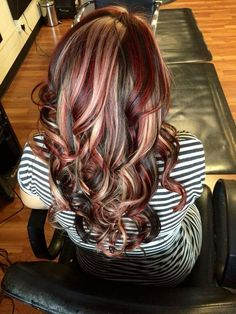 Red and blonde highlights in dark hair. Love this!