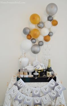 "gold, silver and white balloon ""confetti"" or ""champagne bubbles"" backdrop"