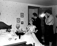 1963: A woman taking picture of President Lincoln in his deathbed at the London Wax Museum - Saint Petersburg Beach, Florida
