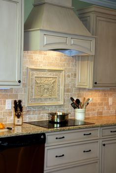 Kitchen Remodel: Braydon Manor Flat Panel Maple Irish Creme Cabinets, Giallo SanFrancisco granite countertops with a standard edge, Durango tumbled Travertine backsplash with Astodor Travertine Listello, Macchiato mosaic, boccocoppa travertine and Urbis Siena Travertine accents, hardwood floors  Work by: TrendMark, Inc. www.trendmarkinc.com