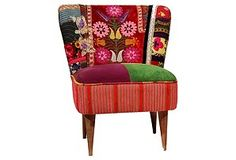 I'm kinda diggin' on these patchwork chairs...would be cute in the bedroom