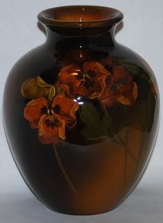"Beautiful Rookwood Pottery standard glaze vase decorated with pansies.   Bottom marked with logo, date mark, shape number and cipher for Caroline Steinle.  Vase is 6 3/4"" tall and 5"" wide."