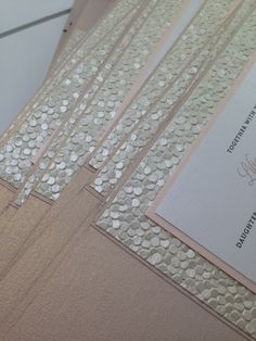 Sneak peek at our production table! Currently obsessing over these Blush, gold and white invitations with the prettiest pebble embossed paper.