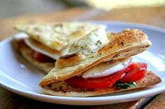 Tasty Caprese mini sandwiches made with Parmesan toasted flatbread, sliced tomatoes, fresh Mozzarella cheese, and basil.