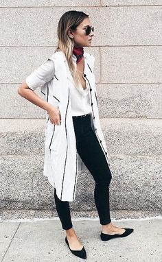 A striped long vest, black skinnies, and a handkerchief