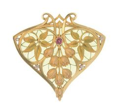 AN ART NOUVEAU 'LILLY OF THE VALLEY' ENAMEL, DIAMOND AND RUBY BROOCH   Designed as a shield-shaped green plique-à-jour enamel and 18k gold scrolled plaque centering upon pink and gold enamel lilly of the valley, with green and gold enamel leaves, enhanced by a cabochon ruby and collet-set diamonds, enamel intact, diamonds, nice color and clarity, ruby, nicely saturated, circa 1900