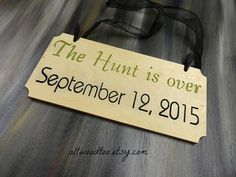 Wood Wedding Signs The Hunt Is Over Sign Wedding by AllWoodToo  $24.99  Click on photo to BUY NOW!  Are you looking for an adorable sign to hold for your save the date photos? This sign will be perfect! #allwoodtoo has a variety of signs to select from.  Click here: allwoodtoo.etsy.com to see more!