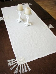 OOAK beautiful natural white/ivory color linen table runner. Measuring 43 1/2x19 (110x48.5cm) it makes the perfect decoration for any table. Table runner decorated with crocheted motifs and linen yarn tassels.  *100% natural linen fabric and yarn *prewashed fabric *hand or delicate machine washing *iron until the fabric a little bit wet. *white/ivory color  ONLY ONE AVAILABLE! READY TO SHIP!  Another sizes are also available ! Please let me know if you need special size of this table runner…