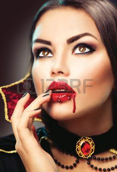 sexy vampire: Halloween vampire woman portrait. Beauty sexy vampire lady with blood on her mouth