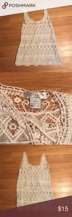 NWOT Crochet knit tank NWOT crochet knit tank top. Size small. Perfect as coverup for the beach or night out. Great condition Tops Tunics