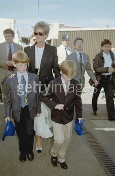 Photo of BRITISH GRAND PRIX for fans of Princess Diana. WILLIAMS DRIVER DAVID COULTHARD OF GREAT BRITAIN SPEAKS WITH HRH PRINCESS DIANA AS SHE VISITS THE PIYS WITH HER SONS BEFORE THE START OF THE BRITISH GRAND PRIX AT SILVERSTONE TODAY