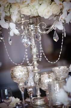 Mercury glass globe votives and candelabra draped in crystal beading can make your table setting look posh without a posh budget!