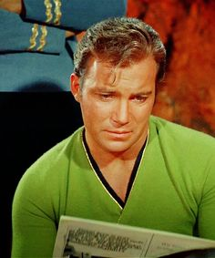 Kirk finding out what kind of culture they've gotten into and Spock standing behind his captain, looking professionally tough.