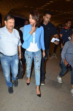 Priyanka Chopra was snapped at the airport before she left for her AIBA performance. The actor left for Dubai to attend the Arab Indo Bollywood Awards 2015. Parineeti Chopra, Neha Dhupia and Salman Khan are already in Dubai practicing for their performance tonight.