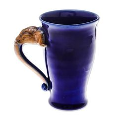 Products Ceramic mug, 'Elephant Handle in Blue' Body Jewelry Article Body: From the ancient period, Thai Elephant, Elephant Head, Ceramic Elephant, Thailand Elephants, Blue Cups, Small Bouquet, Blue Bodies, Funky Jewelry, Pottery Mugs