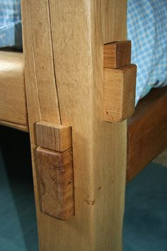 Single sleeper bed showing detail of handmade traditional wedged tennons.