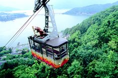 """Tenjosan Park Kachikachi-yama Ropeway. Tenjosan (Mt. Tenjo; 1104m) is consideredto be the model of Japanese folklore """"Kachikachi-yama (Mt. Kachikachi)."""" The reopway connects Kawaguchi-Kohan Station on the piedmont and Fujimidai Station at mountaintop in 3 minutes."""