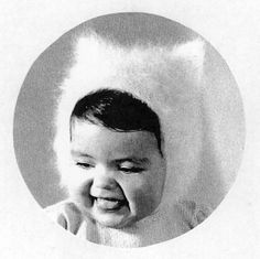 Aw, 1950's baby knit kitty hat. :)