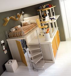 Loft bed, walk in closet underneath. Great use of space!! Wish this was my room!!