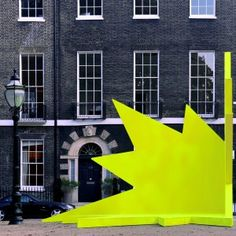 Didier+Faustino's+AA+exhibition+includes+a+spiky+yellow+stage+for+public+speaking
