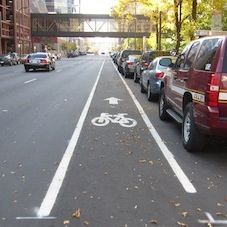 Bike lane, narrow and danger from driver car doors opening and moving vehicles