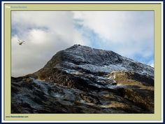The RAF mountain rescue helicopter hovers above Crib Goch in the Snowdon Massif