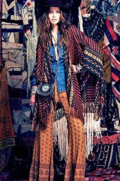 Ethnic inspired tribal print palazzo pants with modern hippie purse for a boho chic allure. For the BEST Bohemian fashion trends FOLLOW https://www.pinterest.com/happygolicky/the-best-boho-chic-fashion-bohemian-jewelry-gypsy-/ now