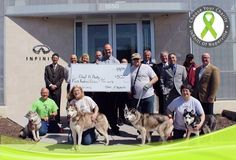 """A big thank you Adopt A Husky, Inc. to representatives Mike F. with Quinn (green shirt far left), Debra R. with Rocky (Front Left side), Mike R. with Rigby (Right of check), Beth F. with Nori (Front right) and Tammie (hiding behind the camera) for taking time to visit with us and accept a $500 donation for their win in March's """"Choose Your Charity"""" contest. Keep posted for more info on a great charity, coming soon!  #ChooseYourCharity"""