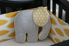 Lots of elephant accessories in this gray and yellow nursery!