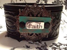 www.etsy.com/shop/journeyondesigns Leather cuff bracelet, handmade from recycled belt, black hand-tooled leather, metal Faith embellishment
