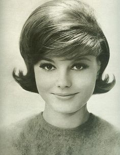 This is the classic 1960's hairstyle for women. They still wanted a lot of body to their hair but the also like it short.