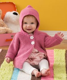 Baby will love this comfy hoodie! It's knit in simple garter stitch with an easycare yarn that new mums will love.