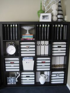 What a great idea - paint white boxes with pewter grey stripes. LOVE the vase with three shell balls too :)