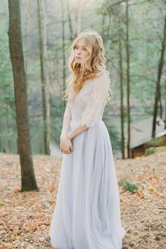 Blue-gray tulle wedding gown with Chantilly lace sleeves