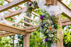 Graceful swags of airy lace and blooms of deep purple, peach and ivory adorn the ceremony canopy at Tara and Matthew's Anthony Wayne House wedding: Bartlett Pear Photography.