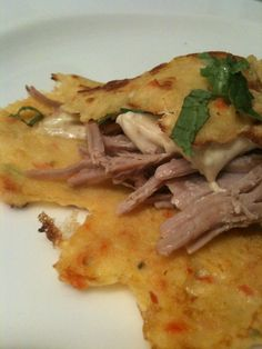 Corn and red pepper crepe stuffed with duck confi , mint and green onion slaw, and corn mascarpone a la michael symon. http://www.facebook.com/photo.php?fbid=10150115071516238