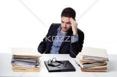 stressed businesswoman at work. - Image of a stressed businesswoman at work, Model: Adam Mirani