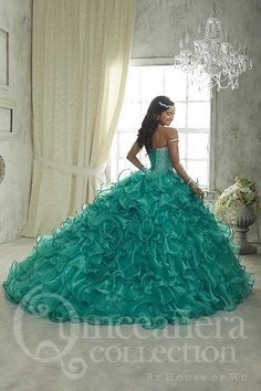 Showing off stylish beadwork on its sweetheart bodice, this Quinceanera gown completes your party look with a full chapel train ball gown complemented by its organza, satin-edge ruffles. Download the