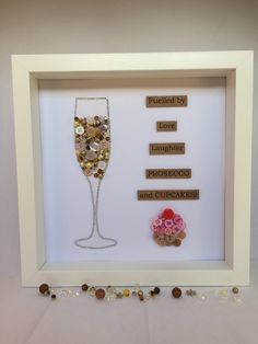 9 x 9 framed button art This can be in black, white or wood frames. Beads of a variety of colours. This frame can be personalised with scrabble letters with a name. This is included in the price. Any extra words will have an additional charge. Frame has a Perspex screen Each