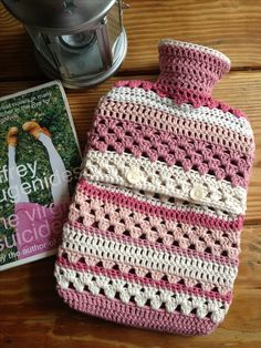 Crocheted hot water bottle cover More