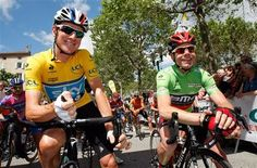 Sky's Bradley Wiggins of Britain, left, wearing the yellow jersey, talks with BMC's Cadel Evans of Australia, wearing the green jersey, at the start of the second stage of the 64th Dauphine cycling race, Lamastre-Saint Felicien , in Lamastre, southern France, Tuesday June 5, 2012.