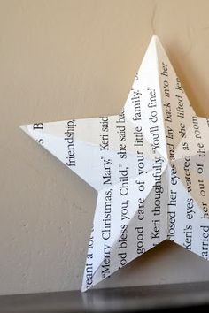 I was in need of a star to top a rolled paper Christmas tree I am working on, so to be all matchy matchy, I made it out of paper. Book...