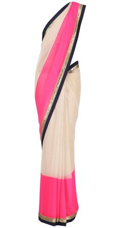 Nude net Sari with neon pink chiffon and navy blue raw silk and gold embroidered border by MANISH MALHOTRA. Shop at https://www.perniaspopupshop.com/valentines-special/manish-malhotra-1