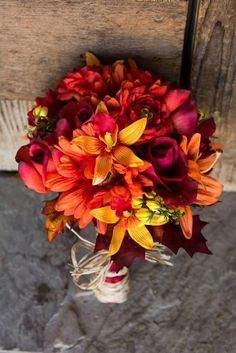 Fall Wedding Bouquet.  DIY bouquet with orange and yellow lilies and burgundy roses and faux leaves!