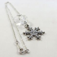 Perfect for all your winter outfits this pretty antique snowflake hangs from a faceted clear glass bead with shimmering silver crystal accents, all on a delicate silver chain. Glass Beads, Jewelry Making, Chain, Crystals, Antiques, Pendant, Silver, Antiquities, Antique