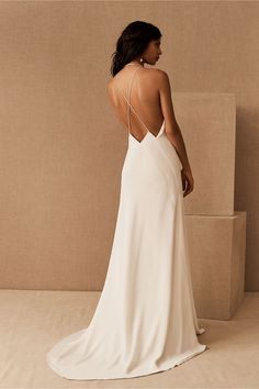 Made from luxurious silk crepe for a richly draped silhouette, this minimalist slip gown features a plunging neckline, strappy open back, and dramatic side slit for a modern look that's unapologetically glam.This item is currently available online only. Arriving soon in select stores; check back for availability! Perfect Wedding Dress, Boho Wedding Dress, Simple Elegant Wedding Dress, Timeless Wedding, Dream Wedding, Minimalist Wedding Dresses, Bridal Outfits, Bridal Gowns, Tea Length Dresses
