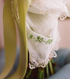 everyone gets complimentary hankies for their bouquets? that way when they're crying because my wedding is so fantastic, they don't have gross tissues. lol