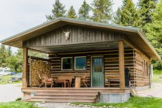 Lester Buildings Pole Barn/Post Frame Montana Log Cabin Home. 3/12 pitch roof in Colony Green, log siding, and porch. #cabin #postframe #polebarn #mountains #rustic #logcabin #design #exteriordesign