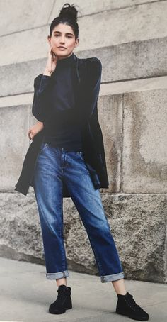 Eileen Fisher velvet shawl collar jacket and boyfriend jeans with leather sneakers.