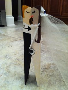 Make Bride and Groom kissing out of a clothes pin :) I even painted the dress to look similar to mine